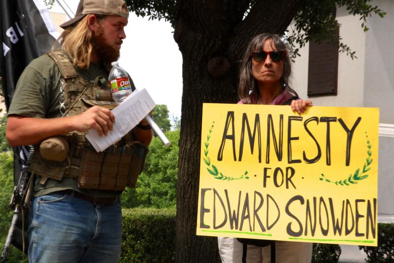 Bo Dresner from San Antonio, left, and Mona Medy from Austin were among the people at the Texas Capitol for a rally against U.S. surveillance programs on July 4, 2013.