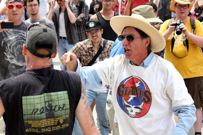 During a rally on July 4, 2013 at the Texas Capitol against U.S. surveillance programs, some got involved in a dispute over attacking the government.