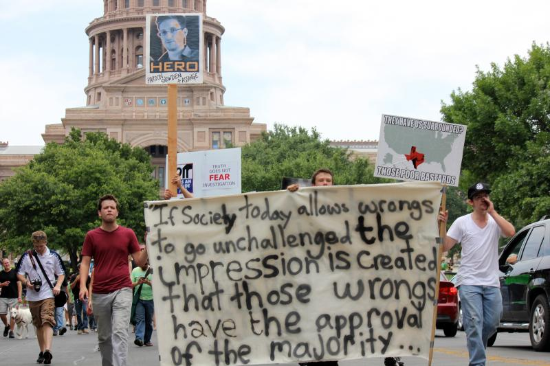 After people gathered at the Texas Capitol on July 4, 2013 to protest against U.S. surveillance programs, they walked down Congress Avenue, escorted by Austin police.