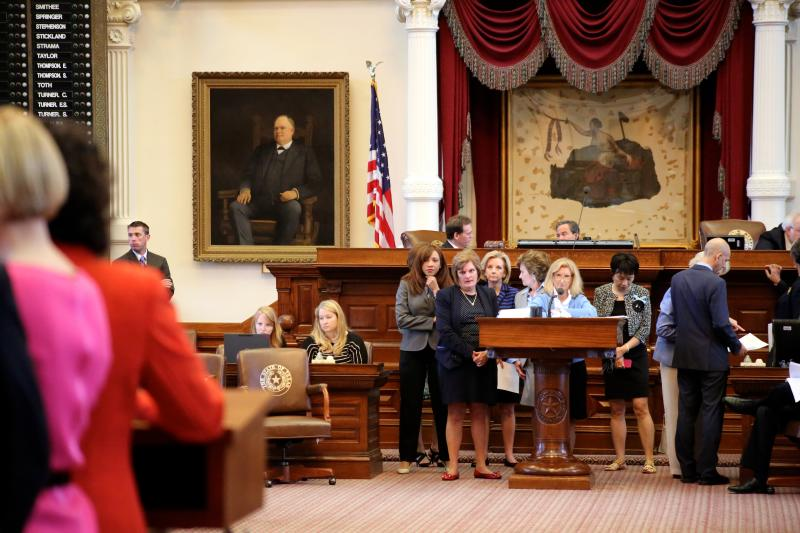 State Rep. Jodie Laubenberg, R-Parker, at the front microphone answers questions from a line of lawmakers during the July 9, 2013 debate on House Bill 2, a restrictive abortion measure.