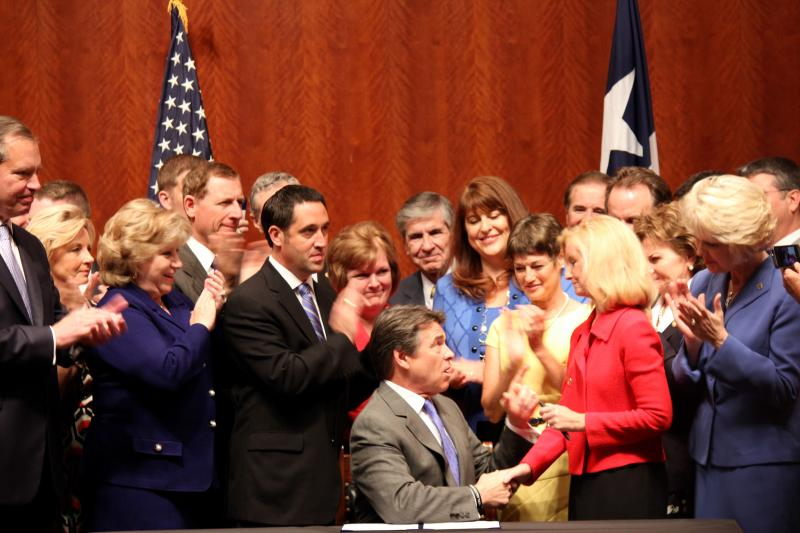 Gov. Rick Perry shakes State Rep. Jodie Laubenberg's hand on July 18, 2013 during a signing event of House Bill 2. Rep. Laubenberg is the author of the restrictive abortion bill.