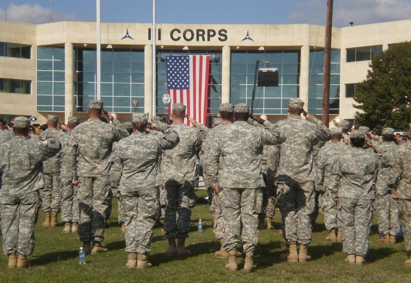 Fort Hood soldiers stand at attention before a 2009 address from Pres. Obama, shortly after the fatal shooting there.