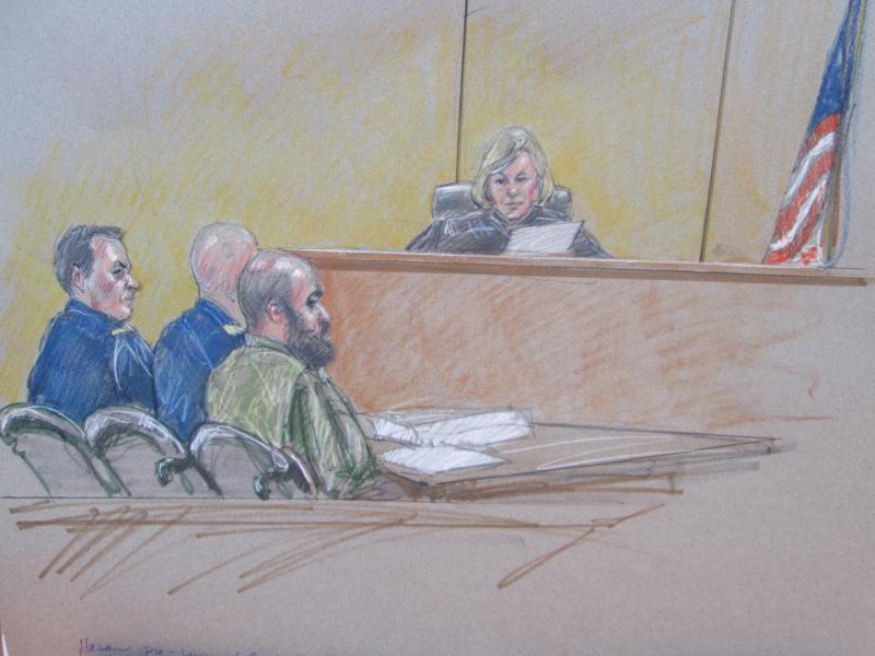 At Tuesday's pretrial hearing, Maj. Nidal Hasan told the trial judge he is being forced to wear his military uniform.
