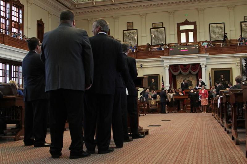 Representatives gathered at the back of the House floor to question Rep. Senfronia Thompson on July 9, 2013.