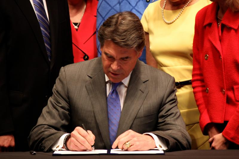Gov. Rick Perry signs the sweeping abortion measure, House Bill 2, into law on July 18, 2013 at the State Capitol.