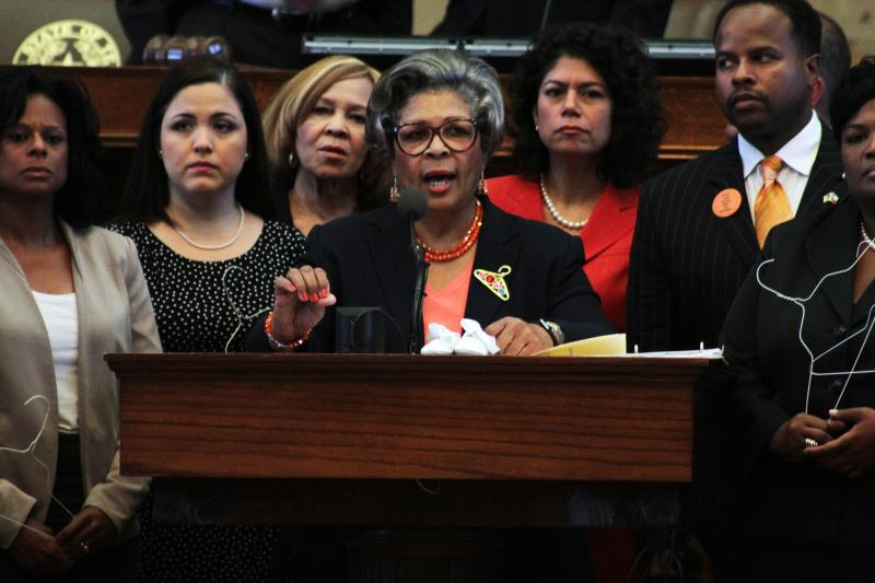 Rep. Senfronia Thompson spoke against House Bill 2, brandishing a coat hanger to signify unsafe, illegal abortions on July 9, 2013.