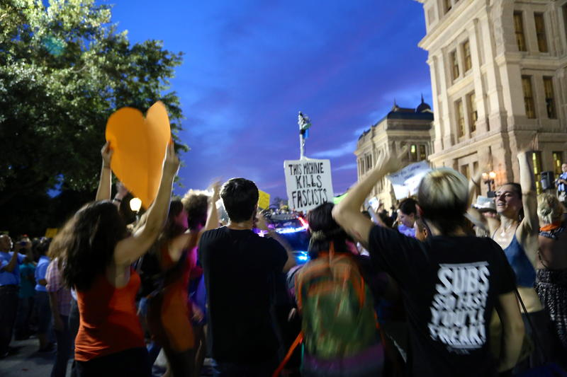 People against restrictive abortion legislation chant and dance at the Texas Capitol on July 8, 2013.