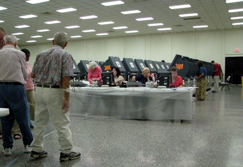 Voters cast their ballots at a Houston polling place. The Texas Public Policy Foundation, traditionally focused on state legislation, is now looking to influence local policy.
