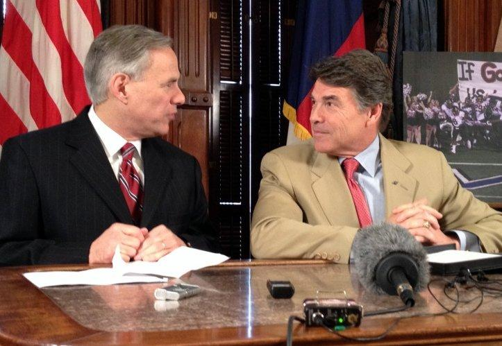 Attorney General Greg Abbott (L) and Gov. Rick Perry at a press conference in 2012. Abbott is widely considered a Republican frontrunner for governor.