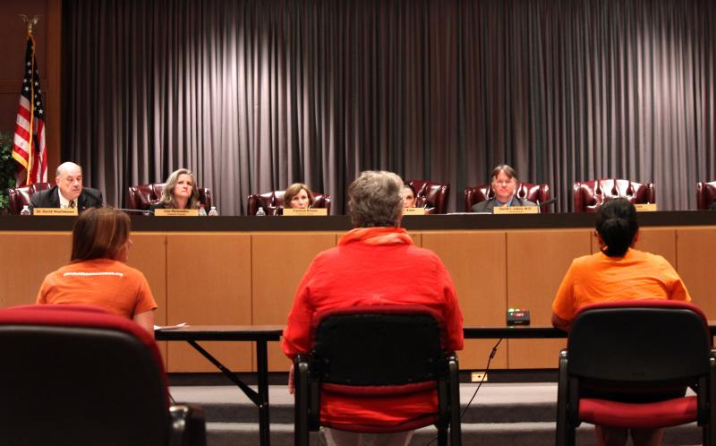 People, some purposely in orange, came to testify before the Texas State Health Services Council on rules written by the health department that specify what abortion clinics must do to operate legally in Texas. The meeting took place on Aug. 28, 2013.