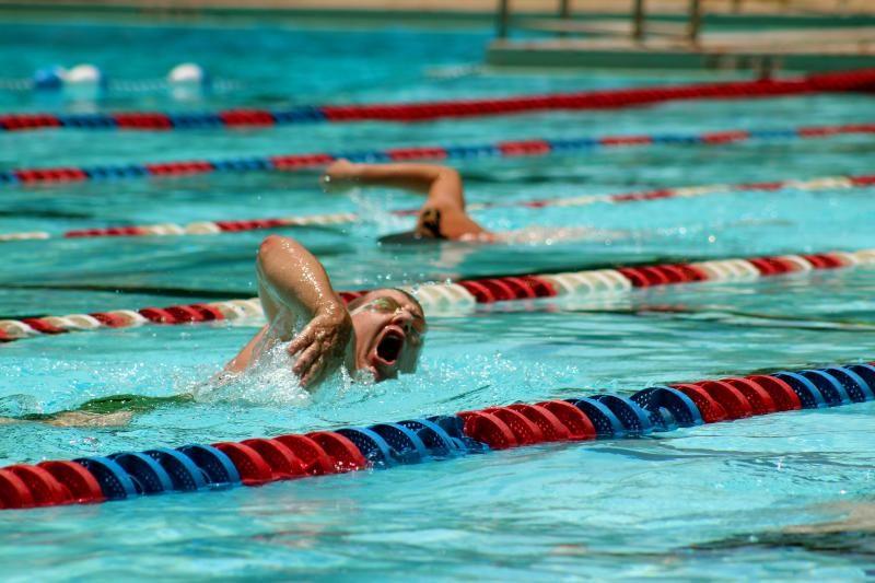 Swimmers take a lap in the Northwest Park (Beverly S. Sheffield) Pool.