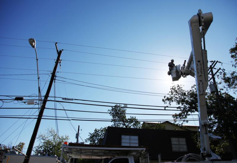 An Austin Energy lineman makes a repair in the West Campus. Austin recently ranked sixth in a study of the most energy efficient U.S. cities.