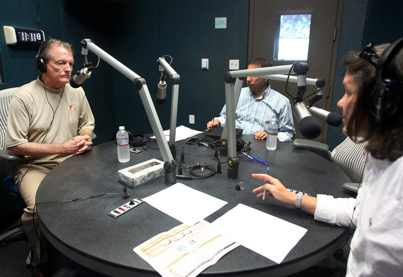 From left to right: UT-Austin President Bill Powers, UT spokesperson Gary Susswein and KUT's David Brown in the KUT studios at the Belo Center for New Media.