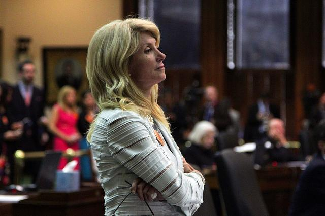 Sen. Wendy Davis, D- Fort Worth, during her famous 13-hour filibuster in June. Davis said she would announce a decision on her political future this month, but her father's death may complicate matters.