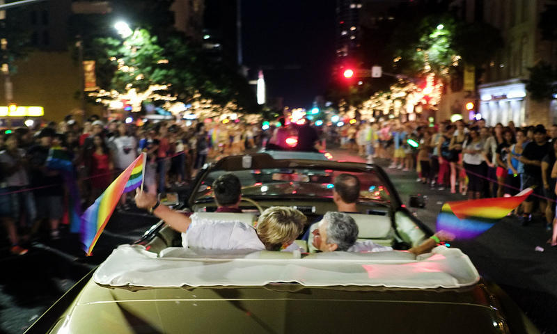 Two Pride participants share a moment during Saturday's parade.