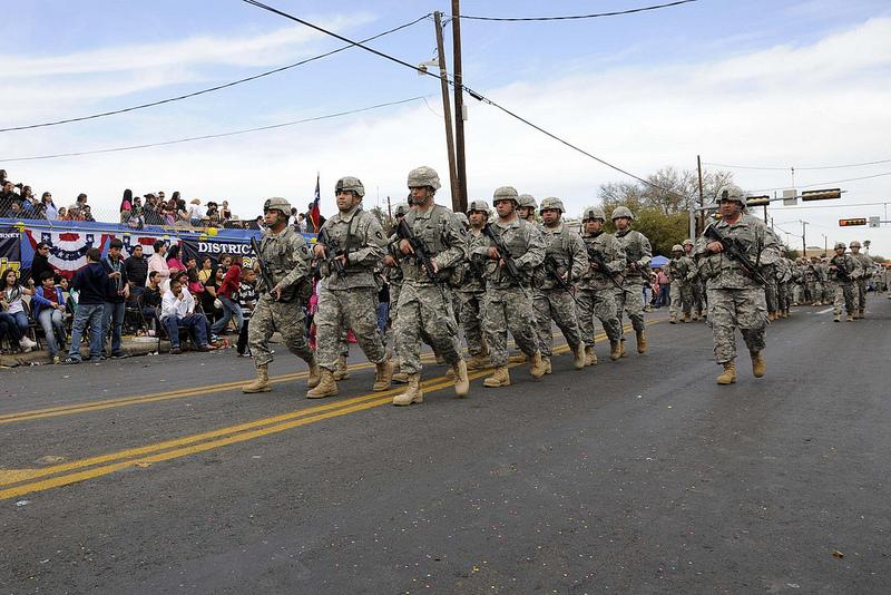 Soldiers from 3rd Battalion, 141st Infantry Regiment of the Texas Army National Guard participate in a parade in Laredo earlier this year. The Texas National Guard won't process benefits for same-sex couples despite a Pentagon directive.