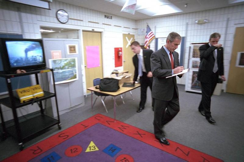 "Bush inside a Sarasota, Fla. classroom the morning of Sept. 11. ""He picked up a notepad and started to collect his thoughts for his first statement,"" Draper says."