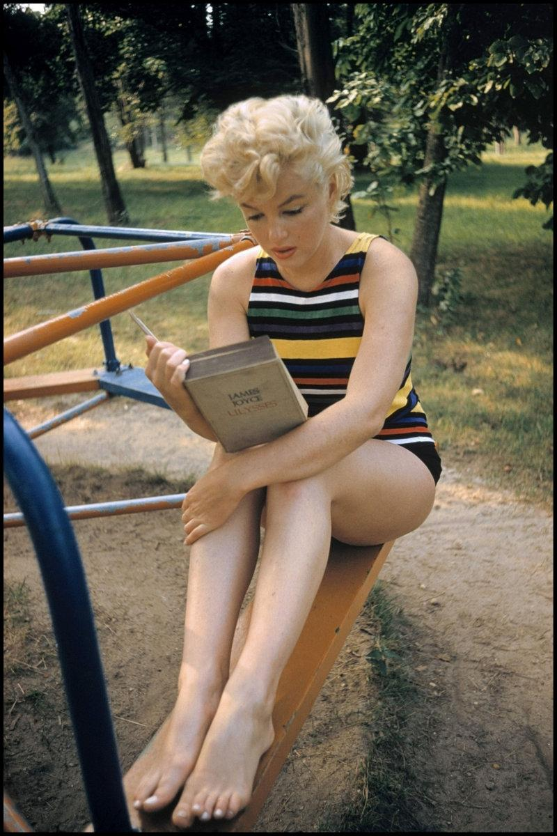 """Marilyn Monroe reading James Joyce's Ulysses,"" by Eve Arnold. ""It defies assumptions about Hollywood's favorite 'dumb blonde,'"" Hoelscher says. ""She's utterly engrossed in reading."""