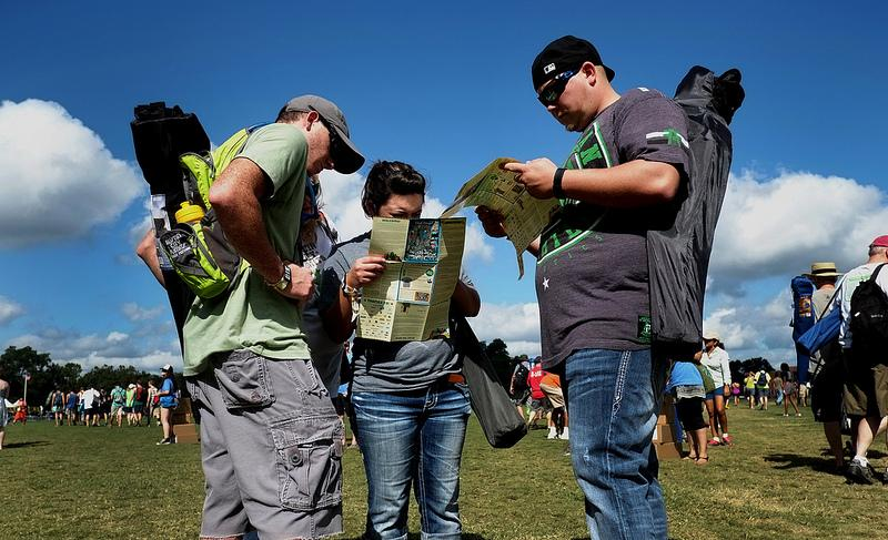 Festival-goers get oriented during the opening hours of Austin City Limits fest. ACL is expected to bring 75,000 visitors to Zilker Park each day.