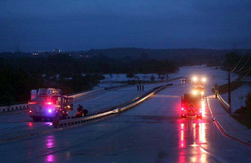 Overnight rain caused dangerous flood conditions throughout Central Texas. The view looking east from Pleasant Valley shows Onion Creek cresting over William Cannon Drive.