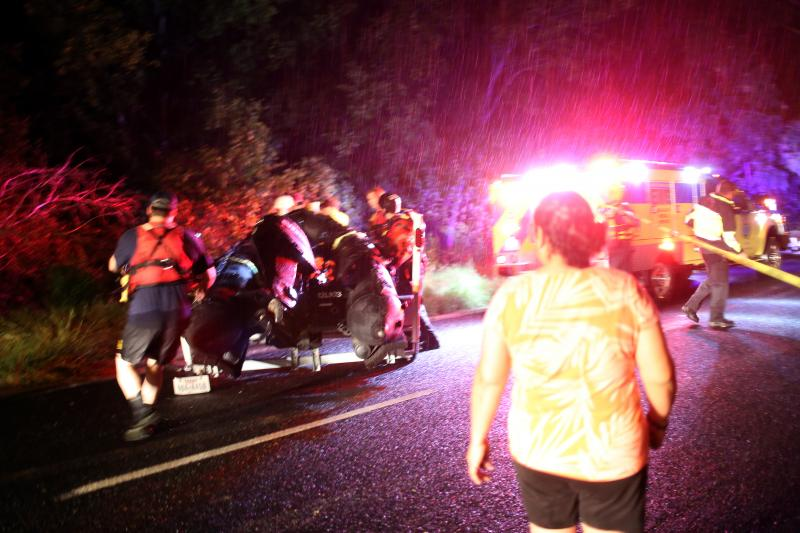 Rescue personal scramble to get a second boat into the water in the area around Pleasant Valley Dr. and William Cannon.