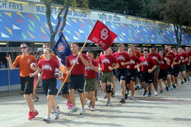 The Texas Naval ROTC, paired with their compatriots at Oklahoma University in 2012. The groups took a run through the state fairgrounds before playing a game of flag football.
