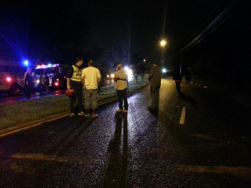 Emergency crews plan a water rescue near Pleasant Valley Road and East William Cannon Drive.