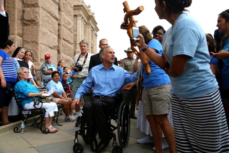 Attorney General Greg Abbott greets supporters of House Bill 2, the state's new restrictive law on abortion.