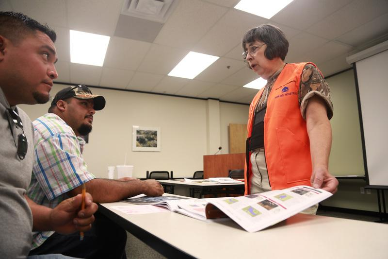 Maria Araujo, right, with Texas Parks and Wildlife, taught a Hunter Education course in Spanish on Sept. 22, 2013 in Austin.