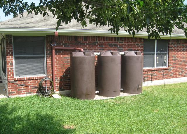 Rainwater harvesters are loving Austin's wet weather. This residential rainwater collection system uses tanks from Austin-based Poly-Mart.