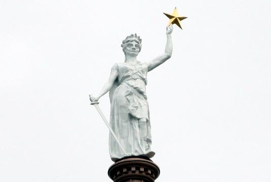 The Goddess of Liberty atop the Texas State Capitol. The government shutdown has slowed the journey of Texas-bound refugees.