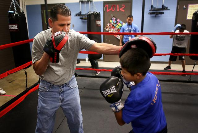 At Mendez Middle School, about a dozen students are learning how to box in a new after school program hosted by the Police Athletic League and the after school program, ACE. Here, Ricardo Ramos spars with Mendez seventh grader Benjamin Munoz.
