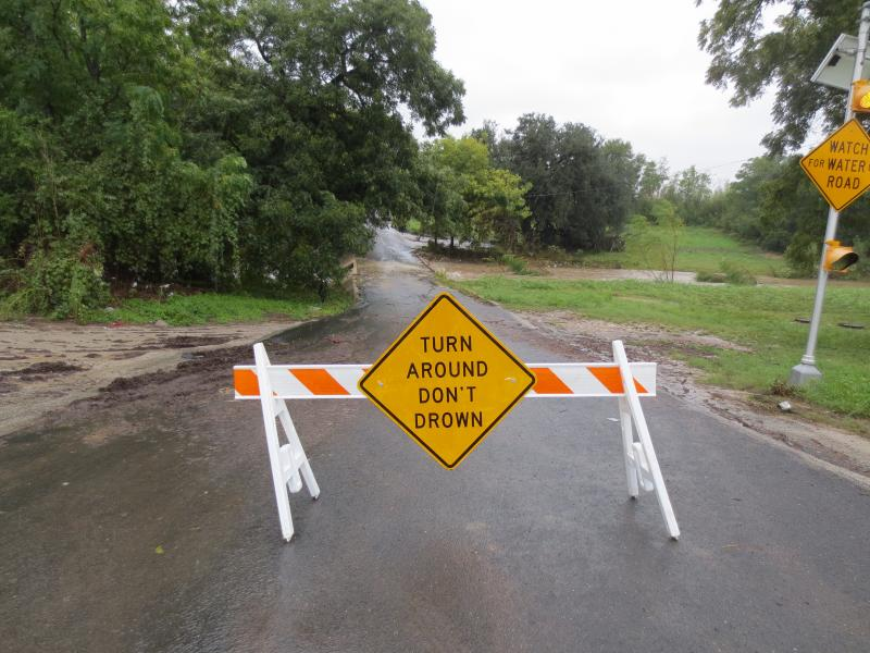 The City of Austin warns drivers to avoid flooded roadways.