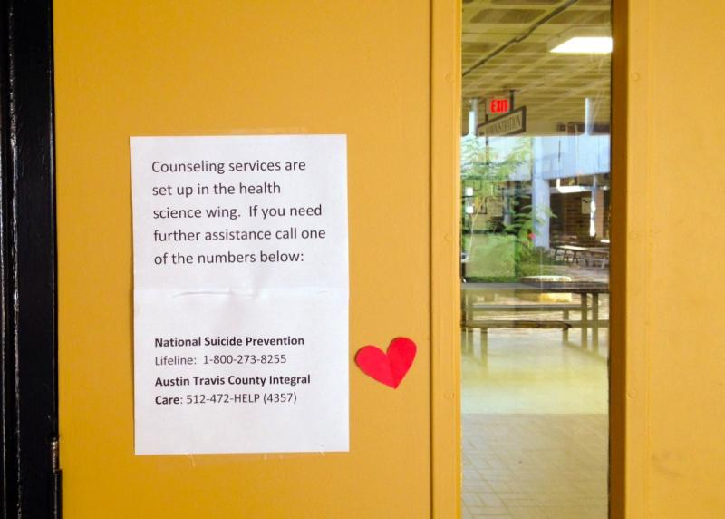 A sign on a classroom door at Lanier High School, urging other students to seek counseling after a student shot and killed himself there this week.