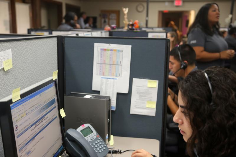 United Way and Central Health navigation specialists answer phone calls on Oct. 1, 2013, the launch date of the federal health insurance marketplace.