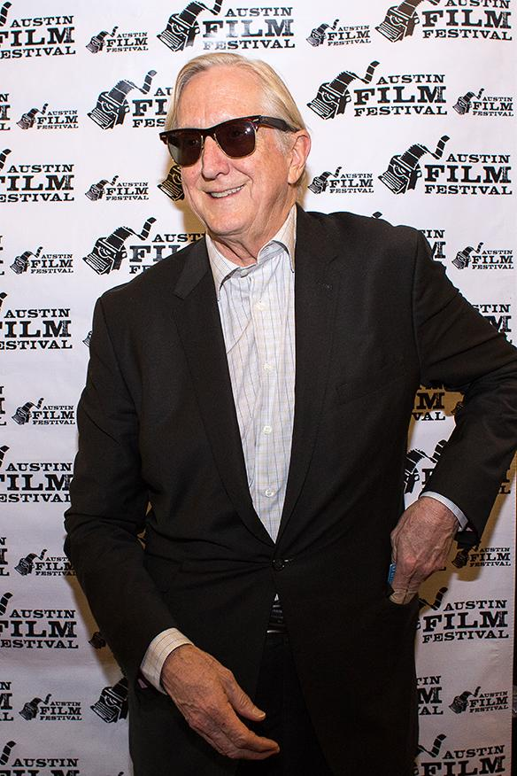 "T-Bone Burnett walks the red carpet prior to a screening of his upcoming movie ""Inside Llewyn Davis"" outside the Paramount Theatre."