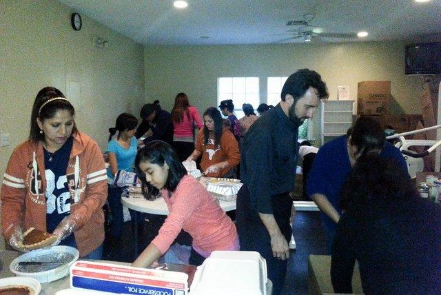Volunteers prepare Thanksgiving Dinner for Onion Creek flood victims Sunday. Overall, they served 120 meals and delivered dozens more to families affected in the area.