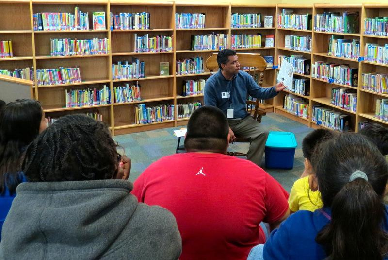 "Pastor Richard Villarreal reads ""Aladdin"" to fourth graders at Langford Elementary."