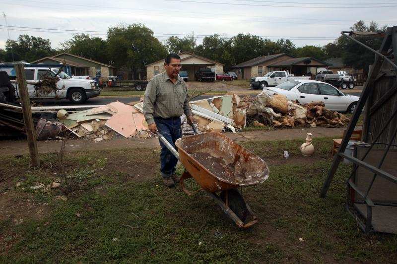 Three days after floods devastated communities around the Onion Creek area, residents continue the clean-up. Ricardo Fabian cancelled his flood insurance three months ago when he paid off his mortgage, he says he will rebuild his home himself.
