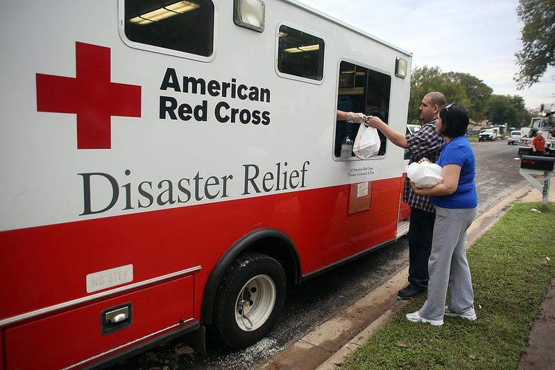 The American Red Cross hands out hot lunches to residents of the Onion Creek community. The neighborhood was devastated by torrential rains that fell on Oct. 31.