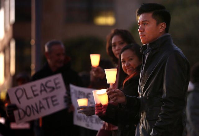 Members of Austin's Filipino community and others gathered downtown last night to honor Typhoon Haiyan victims.