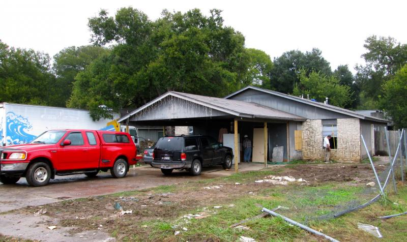 Homeowners begin to repair a flood-battered house on Nov. 4.