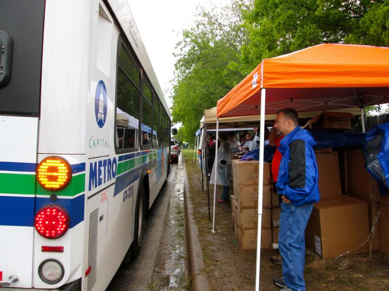 Cap Metro used buses to bring volunteers into the Dove Springs neighborhood to help with clean up efforts