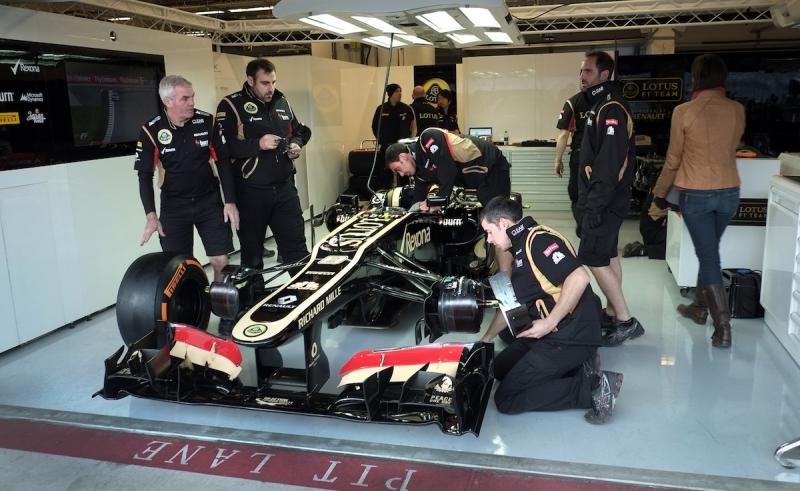 A formula one car is assembled in the Lotus Formula One garage.