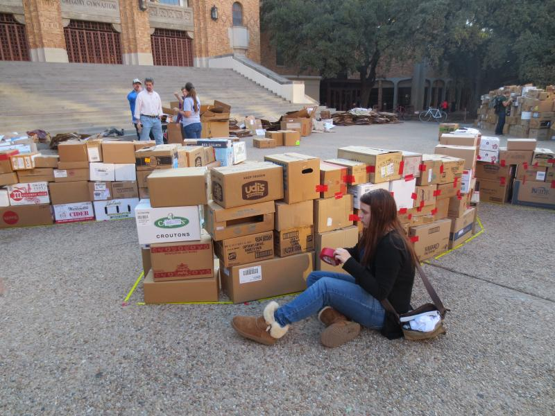 A student works on the box castle.