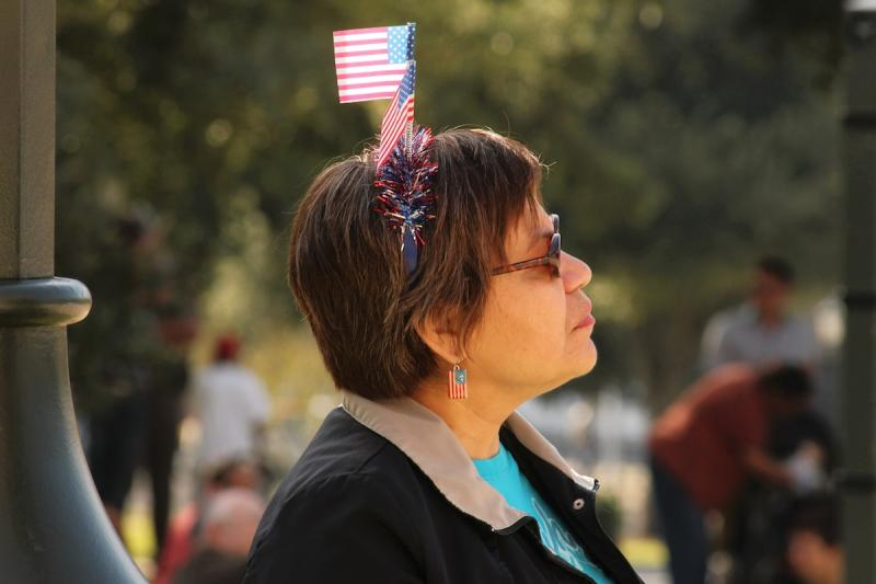 JoAnn Flores didn't make it on time to see the parade, but she patiently waited on the lawn of the Texas Capitol for the ceremony to begin.