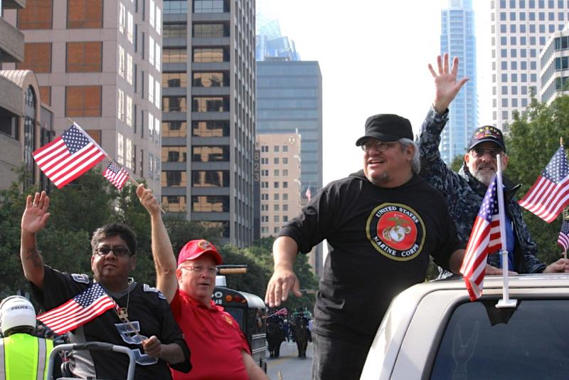 Veterans waved to the crowds as they headed toward the Capitol during today's parade.