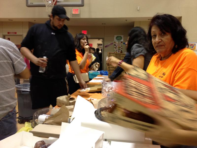 Austin residents affected by the recent flooding received pizza at the cafeteria of Perez Elementary School on Nov. 5, 2013.