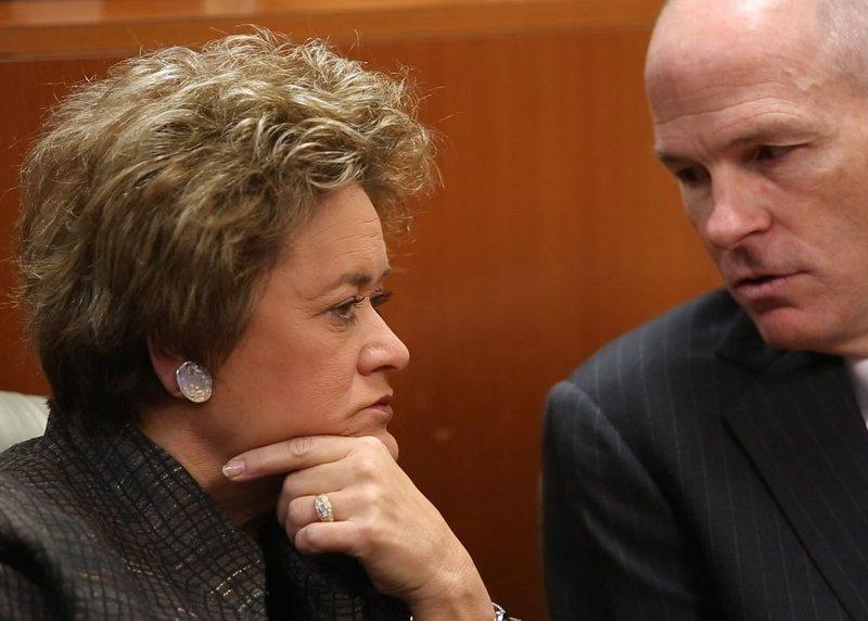 District Attorney Rosemary Lehmberg, left, talks to attorney Dan Richards before the start of her civil trial Monday, Dec. 9.