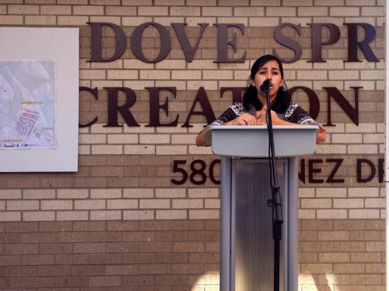 Mayra Lopez, a promotora de salud with the Latino Health Care Forum, spoke at the Dove Springs Recreation Center on Dec. 17, 2013.
